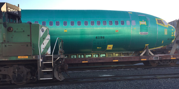 A train & a 737 jet fuselage at Interbay